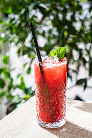 Summer cocktail with strawberries and mint