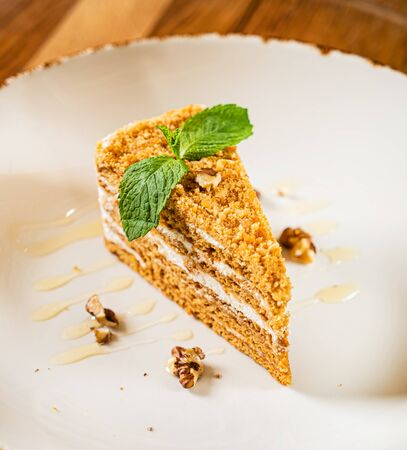 Honey cake with walnut and mint