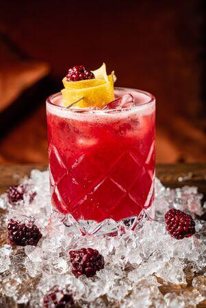 cocktail wiht fresh blackberries and lemon