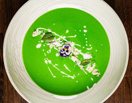 broccoli cream soup on the wooden background