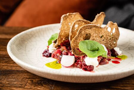 beef tartare with radish and bread chips