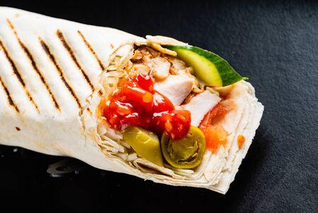 fajita wrap sandwich on the black background