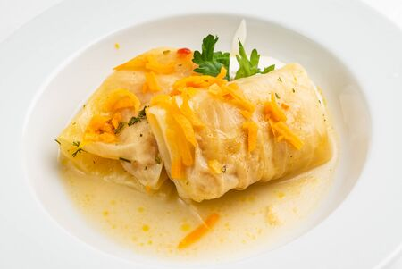 lahanodolmathes with broth based sauce and dill