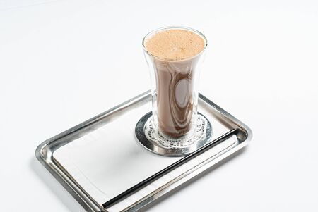 hot chocolate with cinnamon on the white background