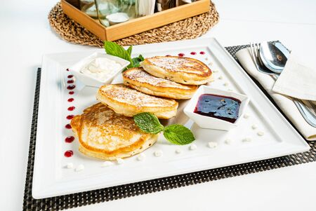 fresh pancakes with sour cream and jam 写真素材