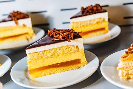 mango cake with chocolate and jam