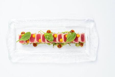sliced steak of tuna with sauce
