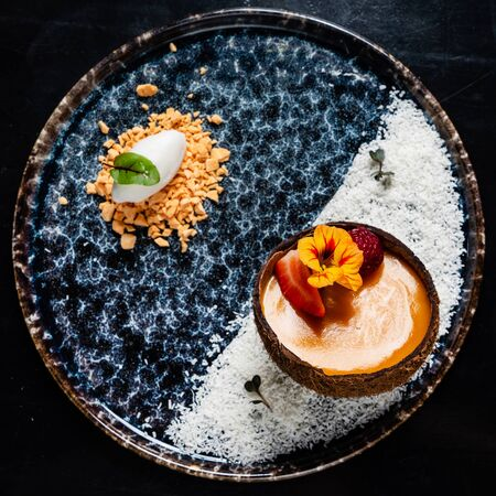 coconut dessert with mango and berries