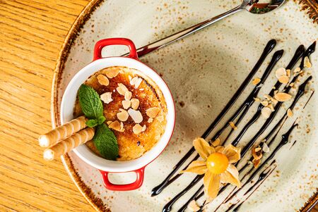 caramel dessert with waffle and physalis Stock Photo