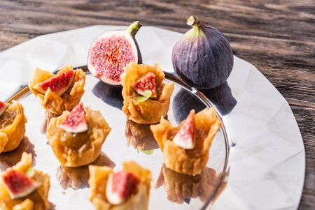catering appetizers with fresh fig Фото со стока