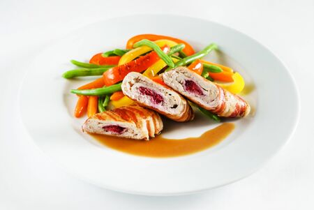 stuffed chicken with vegetables on white