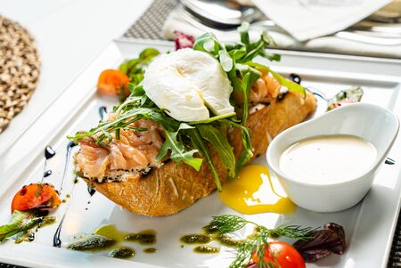 sandwich with salted salmon and poached egg Stock Photo - 129496904