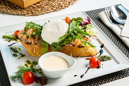 sandwich with salted salmon and poached egg