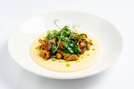 polenta with chanterelles on the white plate