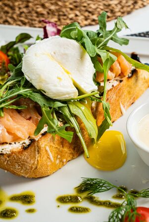 sandwich with salted salmon and poached egg Stock Photo - 129499231
