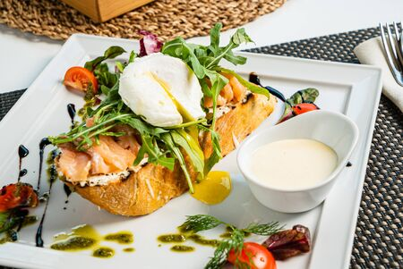 sandwich with salted salmon and poached egg Stock Photo - 129514301