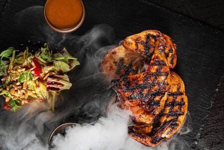 grilled chicken with salad and sauce