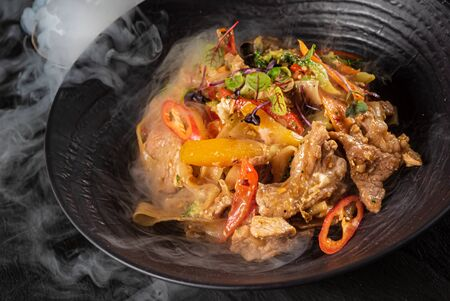 meat with vegetables on the black plate Stok Fotoğraf