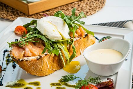 sandwich with salted salmon and poached egg Stock Photo - 129996027