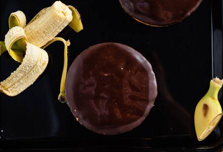 tasty banana cake on the black background