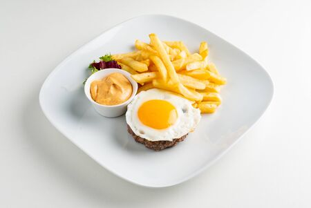 cutlet with egg and french fries