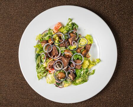 salad with chicken liver and vegetables