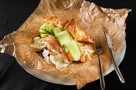 croissant with salted salmon and cucumber Stock Photo