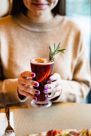 mulled wine with orange and herbs