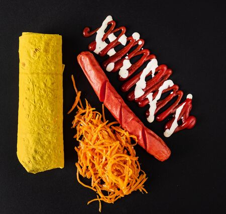 kebab with sausage on the black background