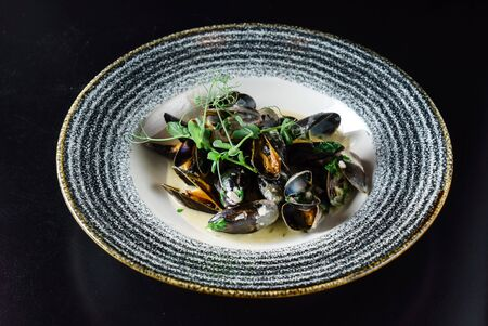 Thai Spicy Mussels on the black background