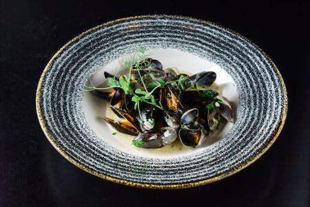 Thai Spicy Mussels on the black background Reklamní fotografie - 131239609