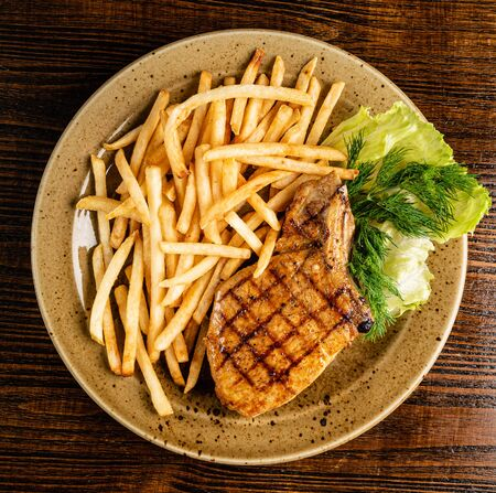 steak with french fries on the wooden background Reklamní fotografie - 131239616