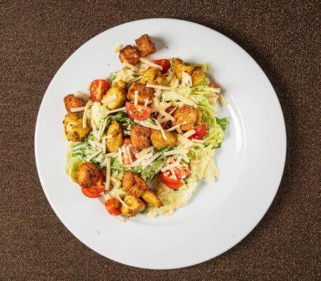 caesar salad on the white plate