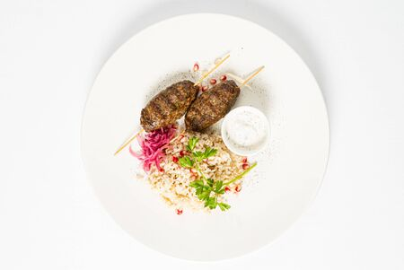 mutton kebabs with rice and sauce Reklamní fotografie