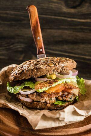 tasty burger with rye bun Reklamní fotografie - 131240374
