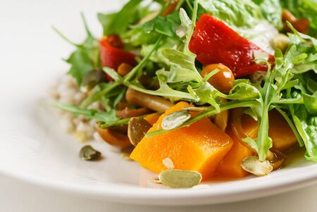 salad with persimmon on the white