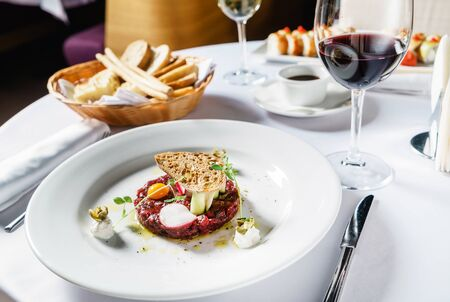 beef tartare with egg and wine