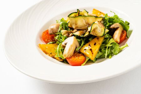salad from grilled vegetables and arugula