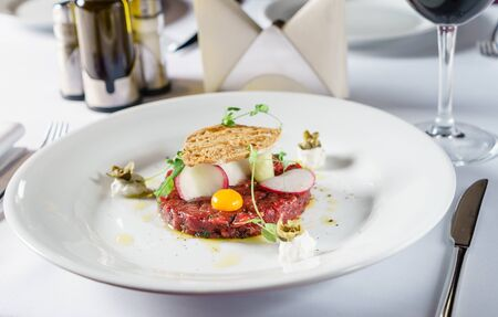beef tartar with egg and radish