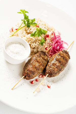 mutton kebabs with rice and sauce Stok Fotoğraf