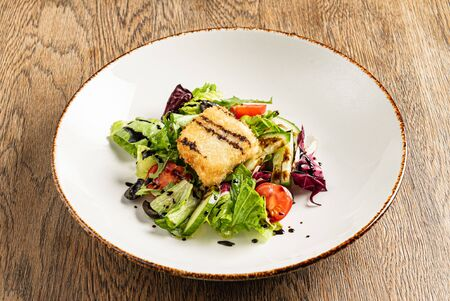salad with fish on the wooden background Archivio Fotografico - 131941673