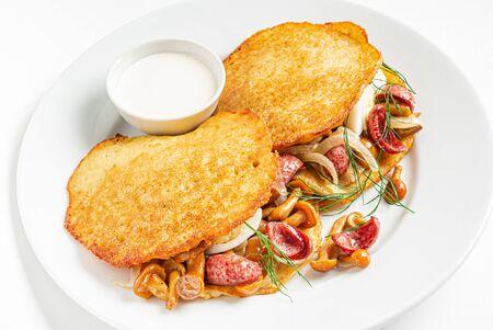 potato pancakes with sausage and mushrooms 版權商用圖片