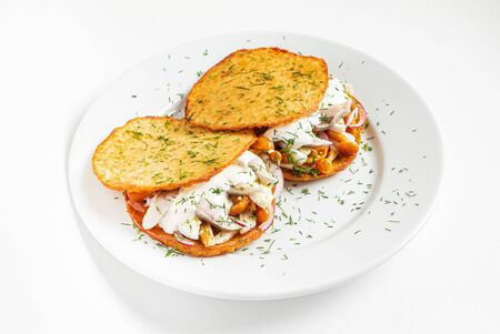 potato pancakes with herring, and onion