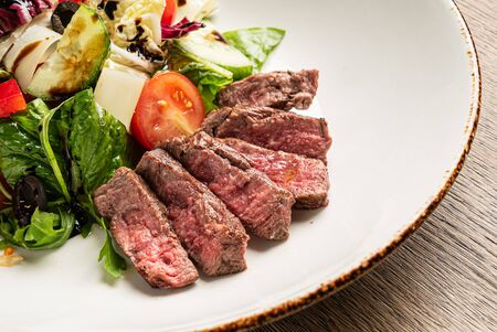 grilled meat with fresh salad