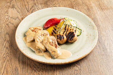 meat with grilled vegetables on the wooden background