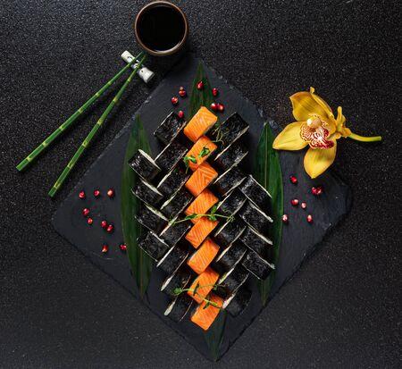 tasty sushi on the black background Stock Photo