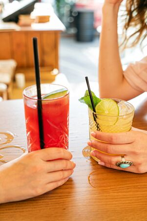 two girls with healthy mocktails in the cafe Stok Fotoğraf - 132614375