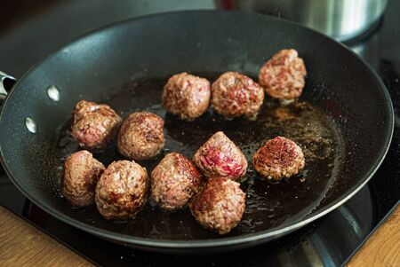 chef making meatballs on the kitchen