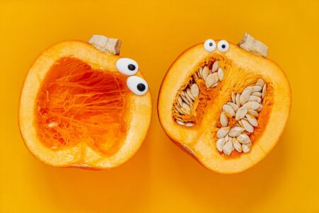 funny pumpkin family on the orange background Stock Photo
