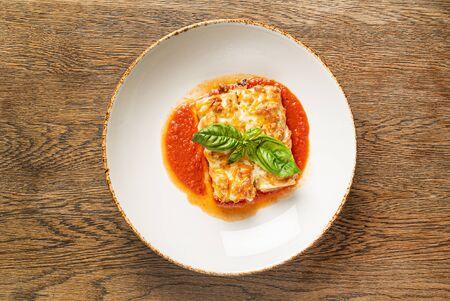 Tasty lasagna with tomato sauce